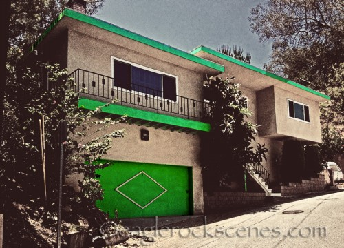 Mid century modern house with green trim
