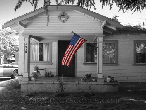 Flag in front of a Craftsman house