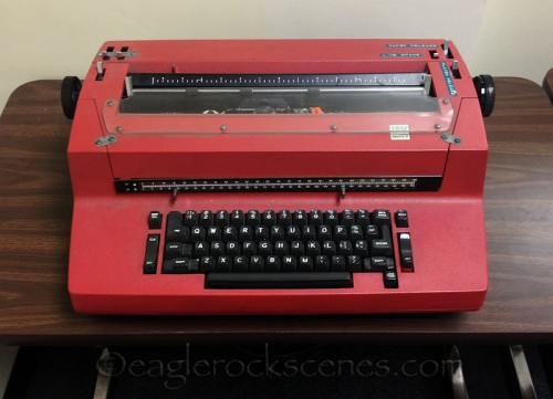 A rather aggressively red hued Selectric typewriter